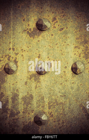 Brown grunge metal plate or armour texture with rivets - Stock Photo