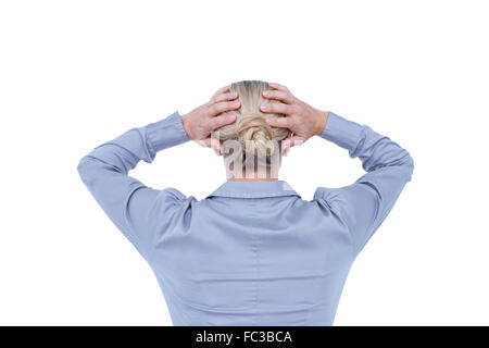 Rear view of worried businesswoman holding her head - Stockfoto