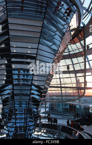 Germany Berlin Reichstag Parliament Interior of Glass Dome  design by Norman Foster  during sunset - Stock Photo