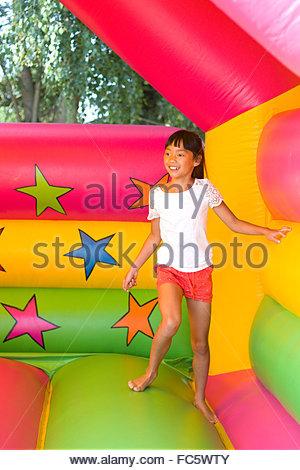 Girl on the bouncy castle - Stock Photo