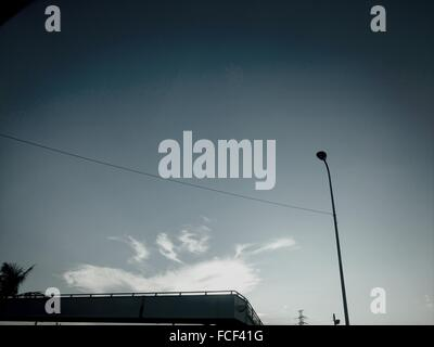 Silhouette Of Street Light Against Blue Sky - Stock Photo