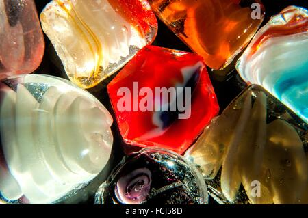 Colorful Translucent glass beads in studio setting - Stock Photo