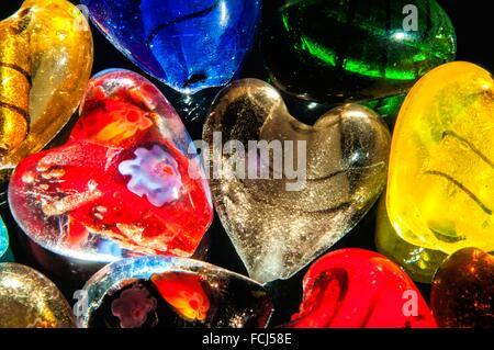 Heart-shaped Translucent glass beads in studio setting - Stockfoto