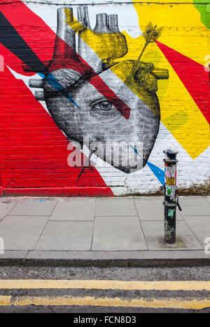 LONDON, UK - JANUARY 13TH 2016: Urban Street Art depicting a human heart and an eye, located in East London, on - Stock Photo
