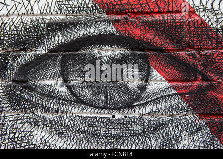 LONDON, UK - JANUARY 13TH 2016: Close-up shot of urban street art depicting an eye, located in East London, on 13th - Stock Photo
