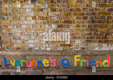 LONDON, UK - JANUARY 13TH 2016: Everyones a Friend colourfullly painted on a brick wall in East London, on 13th - Stock Photo