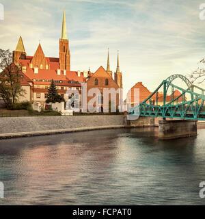 Wroclaw Tumski Island bridge, vivid sunset - Stock Photo