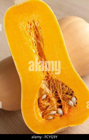 Fresh whole and half butternut pumpkins - Stock Photo