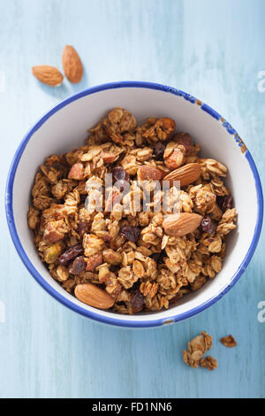 homemade healthy granola in bowl for breakfast - Stock Photo