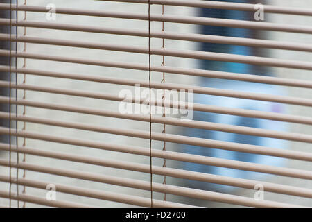 Venetian open blinds, close up image as background on the home window.  Opened  jalousie, gray alu metal shutters. - Stock Photo