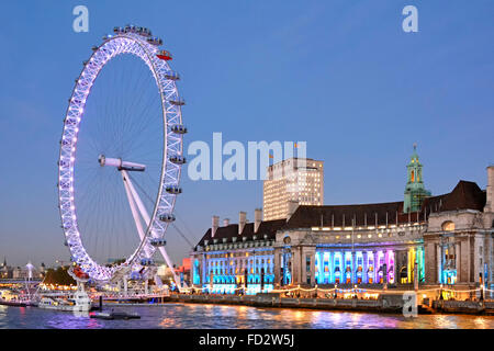 London Eye and the old 'County Hall' building with Shell building beyond - Stock Photo