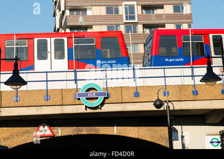 East End Wapping Shadwell DLR train bridge over road TFL Transport for London subway Metro Docklands Light Railway - Stock Photo