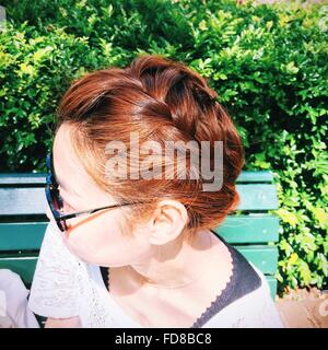 Side View Of Woman With Braided Hair, Wearing Sunglasses - Stock Photo