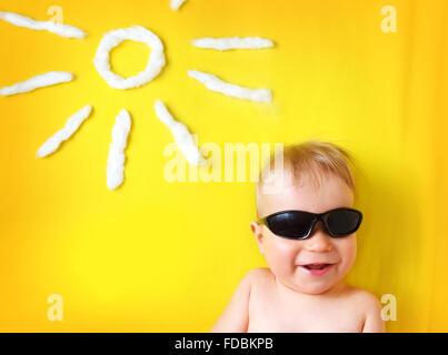 little boy with sunglasses and sun shape - Stock Photo