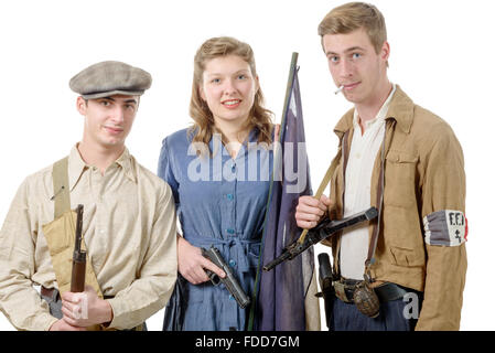 three young French Resistance, vintage clothes and weapons, reenactment - Stock Photo