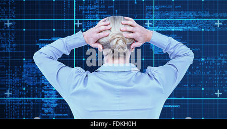 Composite image of rear view of worried businesswoman holding her head - Stock Photo
