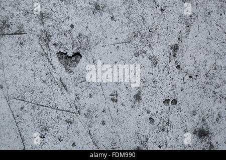Heart in a grey stone wall, grunge style - Stock Photo