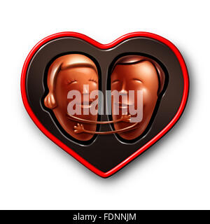 Happy couple in love concept as two lovers made of chocolate candy in a valentines day gift box embracing and hugging - Stock Photo