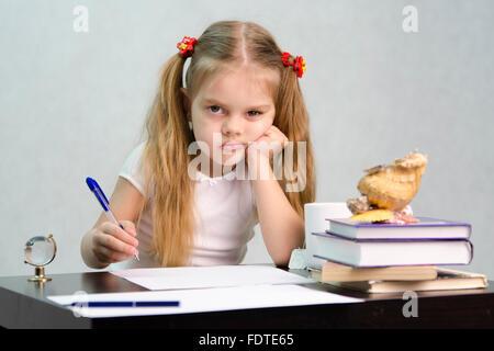girl,stubborn,homework - Stock Photo