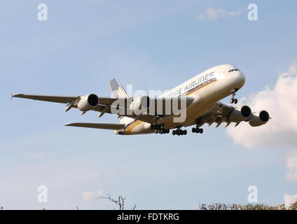 Singapore Airlines Airbus A380-800 9V-SKE landing at London Heathrow Airport, UK - Stock Photo
