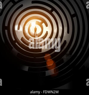 Silhouette of businessman standing in maze sun above - Stock Photo