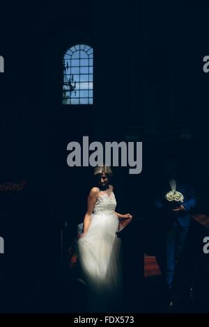 bride and groom illuminated by light - Stock Photo