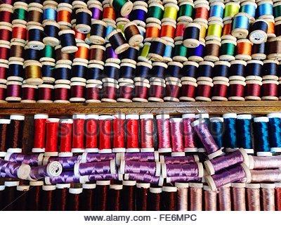 Full Frame Shot Of Colorful Thread Reels Arranged In Shelves - Stock Photo