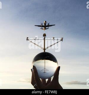 Reflection Of Airplane In Glass Sphere - Stock Photo