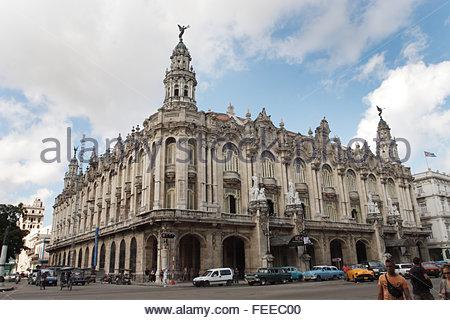 Gran Teatro de La Habana, The Great Theatre of Havana , opened in 1838. people passing, vintage cars on street. - Stock Photo