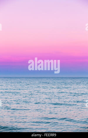 Calm Sea and ocean beautiful pink red sky sunset Sunrise on the horizon, background. - Stock Photo
