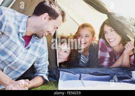 Smiling family in tent - Stock Photo