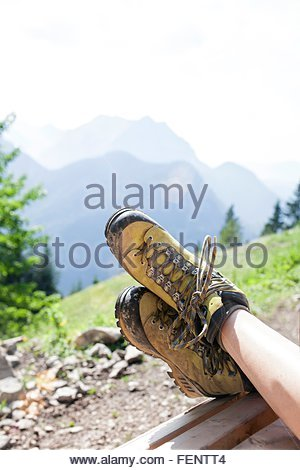 Young girl relaxing in rural environment, focus on feet - Stock Photo