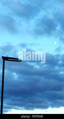 Low Angle View Street Light Against Cloudy Sky - Stock Photo