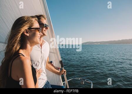 Couple enjoying view on sailboat, San Diego Bay, California, USA - Stock Photo