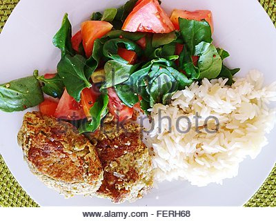Directly Above Shot Of Falafel And Rice With Spinach Salad On Plate - Stock Photo