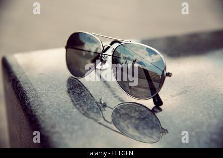 Reflection Of Building On Sunglasses - Stock Photo