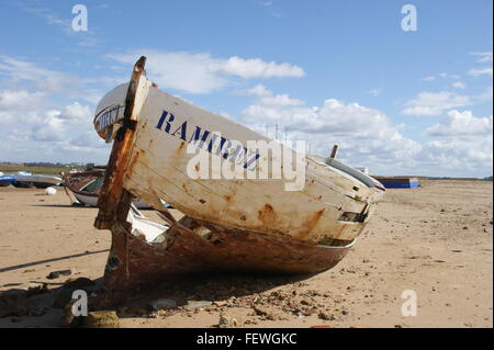 Old Abandoned Boat Moored On Beach Against Sky - Stock Photo