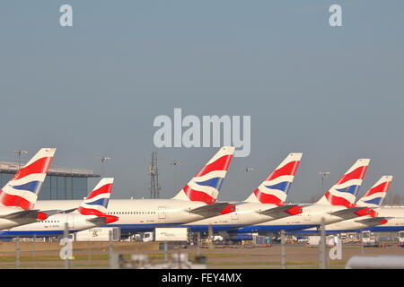 British Airways planes parked at the gate at London Heathrow Airport, UK - Stock Photo