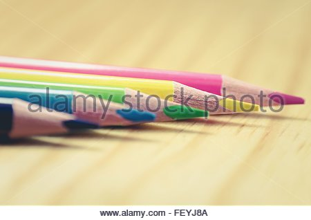 Close-Up Of Colored Pencils On Desk - Stock Photo