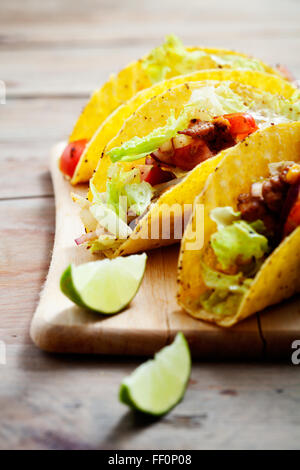 Fresh Mexican tacos with spicy chicken - Stock Photo