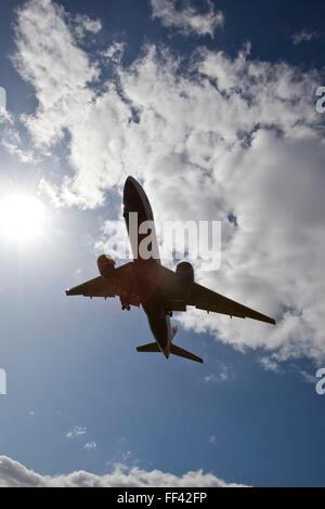 A British Airways Boeing 777 landing at Heathrow airports north runway. - Stock Photo