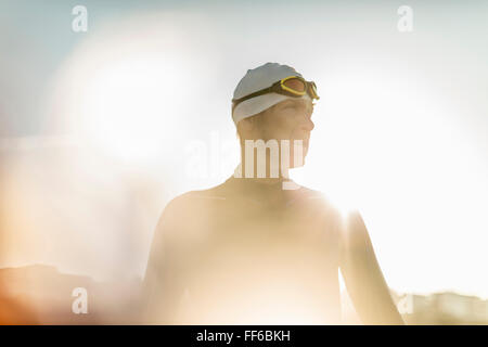 A swimmer in a wet suit, swimming hat and goggles. - Stock Photo