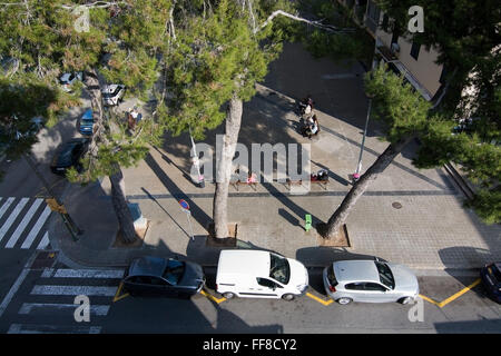 Aerial view down on Can Pastilla square with people on benches in sunshine on December 13, 2015 in Balearic islands, - Stock Photo