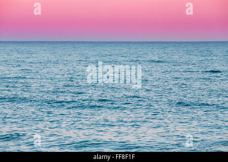 Calm Sea Ocean And Pink Red Sky Sunset Sunrise Background - Stock Photo