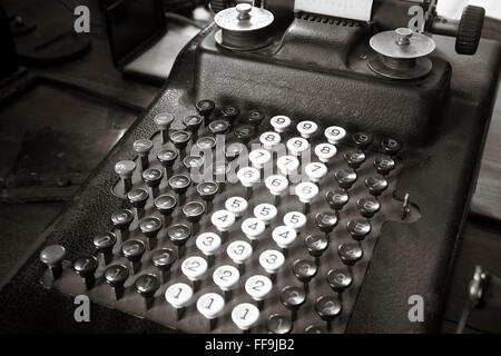 Original antique typewriter calculator in sepia tone. Horizontal - Stock Photo