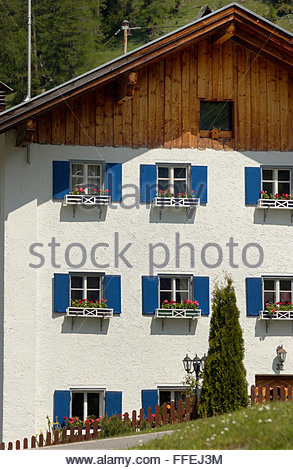 White house with blue shutters window boxes and wooden eaves. Hahntennjoch pass, Imst district, Austria. - Stock Photo