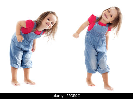 Happy toddler girl wearing jeans jumpsuit is having a great time dancing in the studio. dancing on white. - Stockfoto