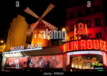 Moulin Rouge Montmartre Paris France in the evening - Stock Photo