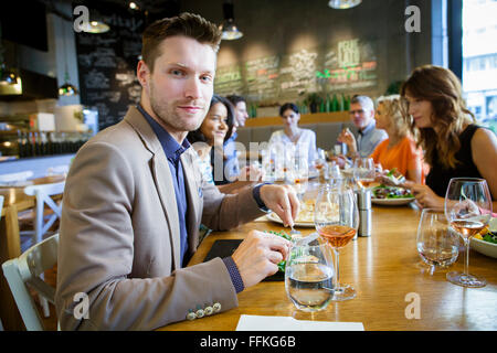 Group of friends celebrating in restaurant - Stock Photo
