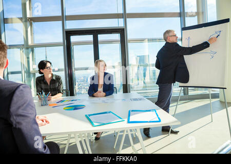 Senior architect giving presentation in business meeting - Stock Photo